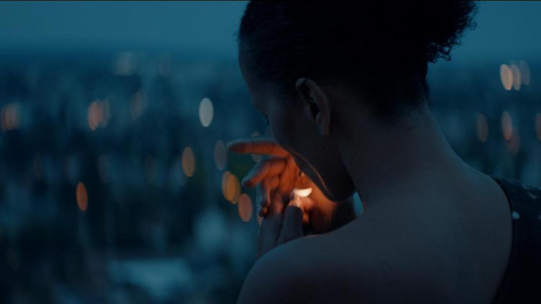 Clarisse Albrecht as Emma in Bantú Mama, lighting a cigeratte in the evening.
